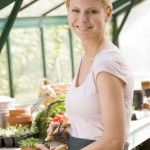 woman gardening in greenhouse